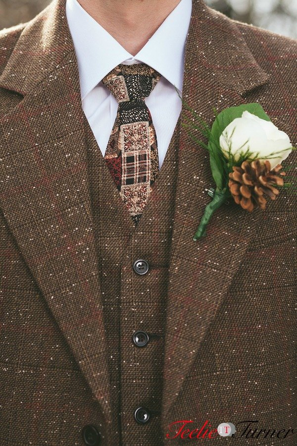 Detail of wedding vintage groom suit with matching tie.