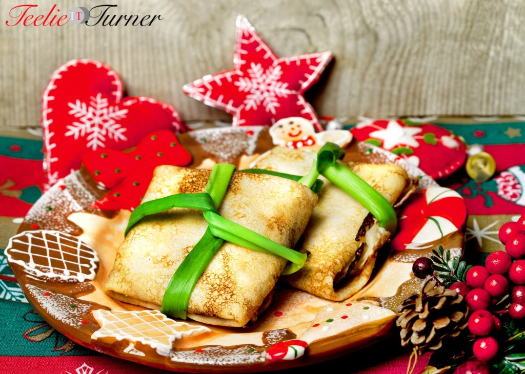 Tasty food pancakes with meat on a holiday and Christmas decor