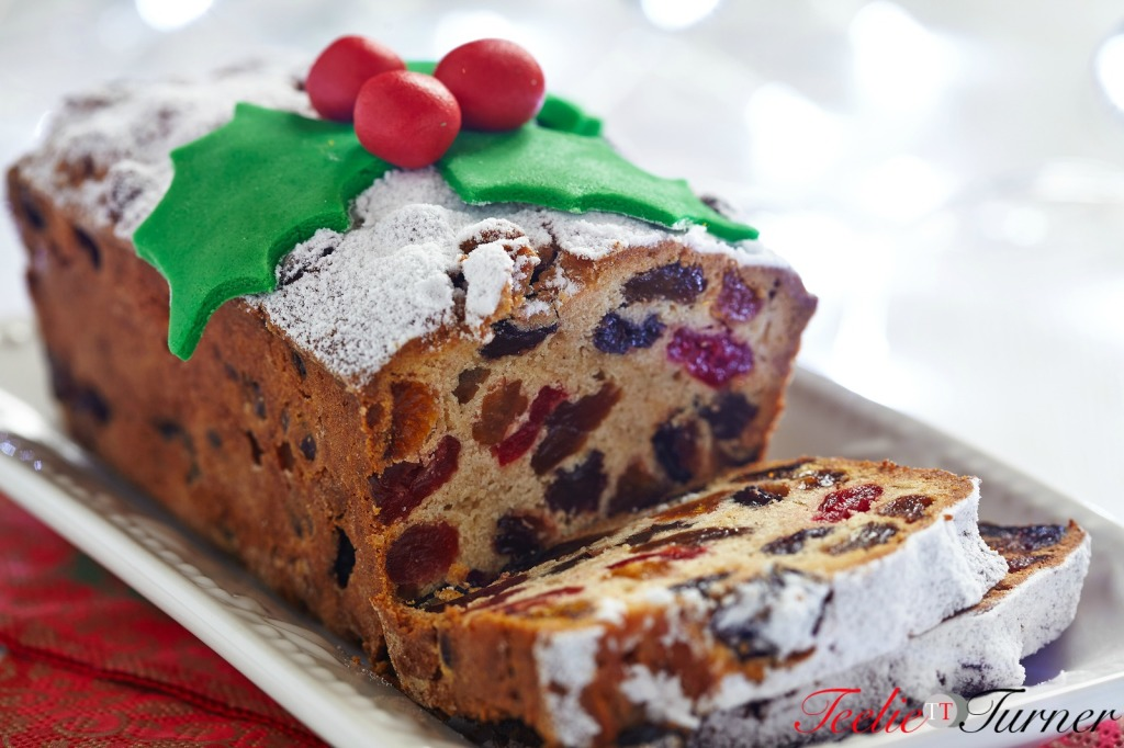 Christmas fruit cake decorated with holly and berries