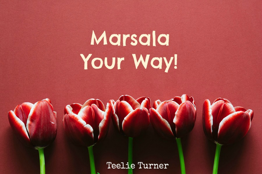 Five marsala colored tulips on marsala paper