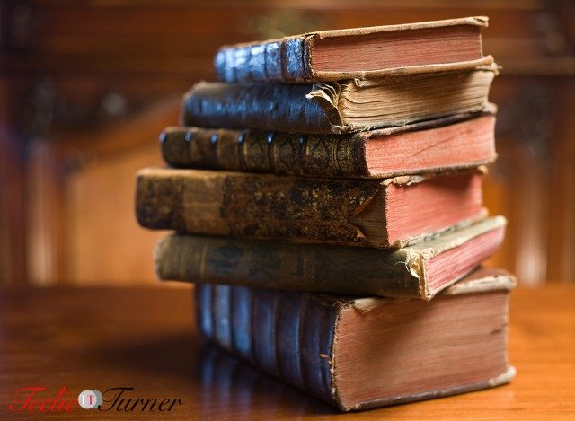 Shot of mysterious looking beautiful worn antique books.