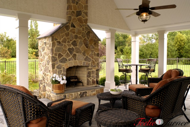 Beautiful outdoor living space with fireplace and vaulted ceiling.